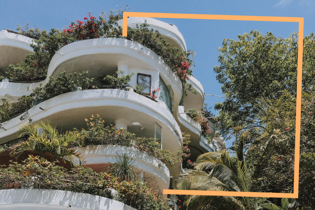 white_villa_with_flowers_growing_on_balconies