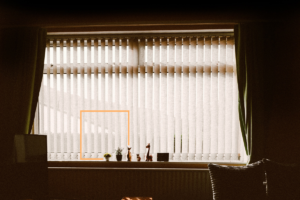 window_with_blinds_on_drapes_open
