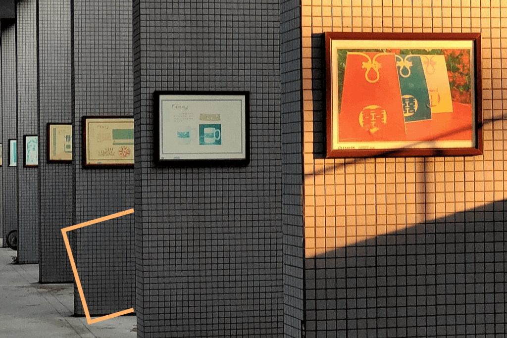 framed_art_pieces_mounted_on_walls