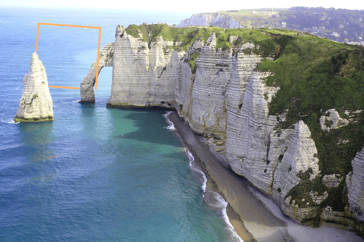 green-cliff-against-sea-top-view