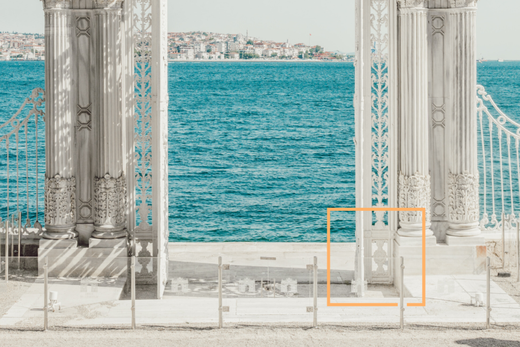 ornamental-white-gate-against-sea-backdrop